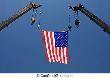 US Flag on Construction Crane - An American flag flies from...
