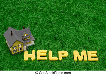 Mortgage Crisis - House with the words help me on grass....
