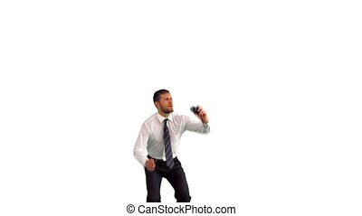 Businessman jumping and taking self portrait in slow motion