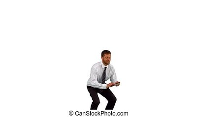 Businessman jumping up holding tabl
