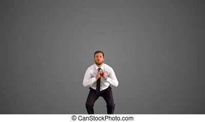Businessman jumping and stretching