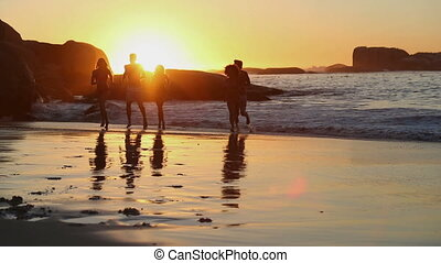 Silhouettes of friends running out