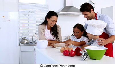Family baking together at home in kitchen