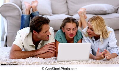 Parents and daughter happily using