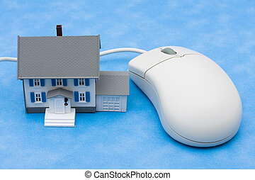 Online Real Estate - House sitting with computer mouse...