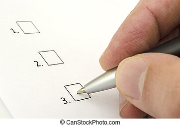 Hand choosing one of the options