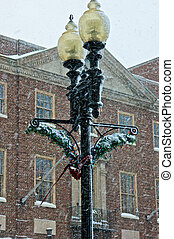 heavy snow - garland and colored holiday lights deorate this...