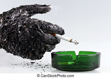 Smoking kills - Ashed hand with a cigarette shows that...