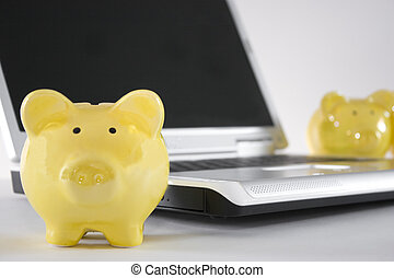 savings banks on lap top - three savings bank piggy bank...