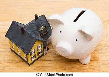 Home Finances - Close up of a home with a piggy bank