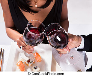 Romantic Couple Toasting Red Wine - Portrait Of Romantic...