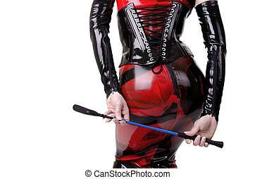 Woman dressed in dominatrix clothes, from back.