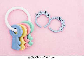 Baby Toy - A pink baby facecloth with toy keys with copy...