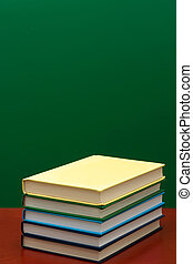 Stack of books on a green background