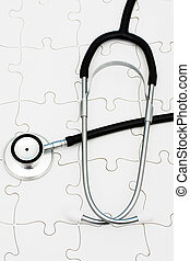 Understanding Heath Care - Stethoscope on puzzle, solving...
