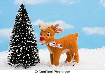Reindeer standing in a snowy winter scene