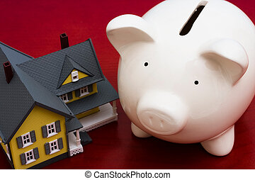 Home Finances - Home with piggy bank on a red background