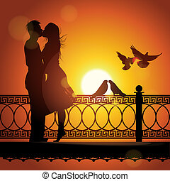 Silhouette of couple in love kissing at sunset - Silhouette...