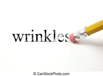 Erasing Wrinkles - The word wrinkles written on white with...