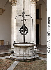 Medieval water well in a cloister