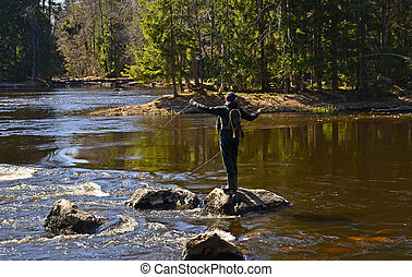 Fishing in a river - Fishing in a salmon river at spring