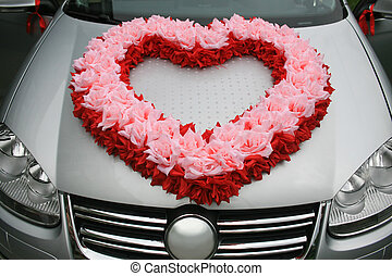 wedding car with heart from flowers on cowl