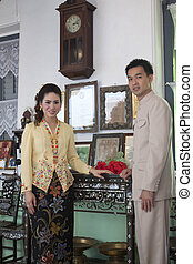 portrait of couple asian smiling with traditional clothing...
