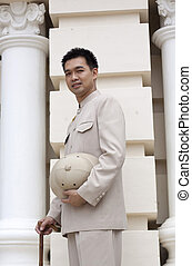 portrait of asian man smiling with traditional clothing...