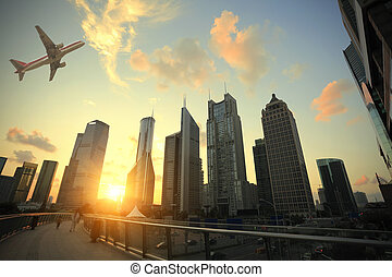 Shanghai,Aircraft is flying in the modern urban buildings -...