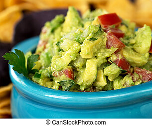 Guacamole 1 - A bowl of fresh guacamole with corn tortilla...