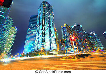 Dreamy blue of modern office buildings at night in Shanghai Far East