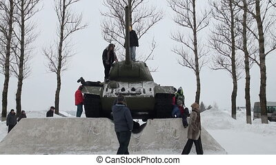 Children play on the tank