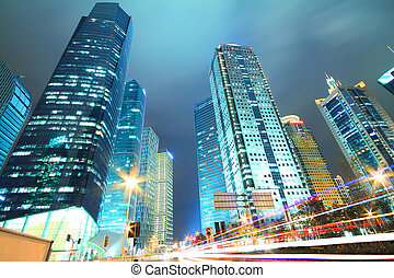 Dreamy blue of modern office buildings at night in Shanghai...
