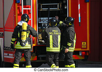 brave firefighters with oxygen tank fire during an exercise...