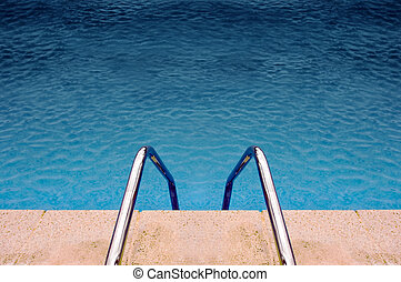 Swimming pool ladder and blue water