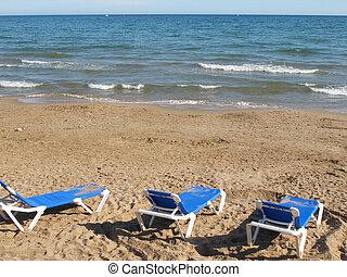 sitges beach - hammocks on the beach sand