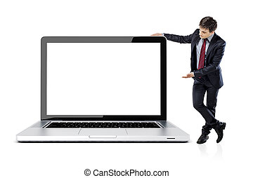 attractive young business man with laptop on white...