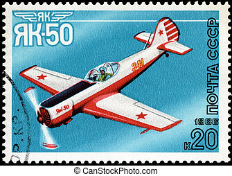 """USSR - CIRCA 1986: A stamp printed in USSR shows the Aviation Emblem """"Yak"""" and aircraft with the inscription """"Jak-50, 1981"""" , circa 1986"""