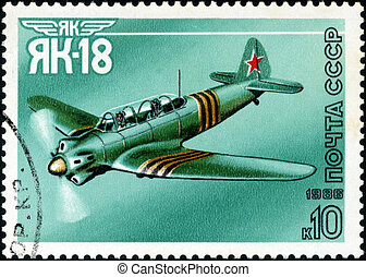 """USSR - CIRCA 1986: A stamp printed in USSR shows the Aviation Emblem """"Yak"""" and aircraft with the inscription """"Jak-18, 1981"""" , circa 1986"""