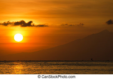 Orange sun with a golden glow - Lombok, Bali - Orange sun...
