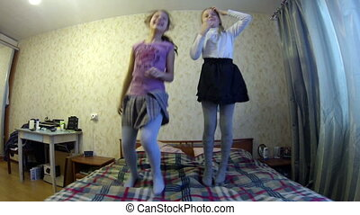 Girls jumping on the bed