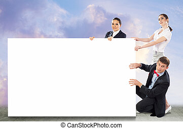 small group of people holding a blank banner, place for text