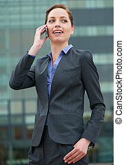 Confident business woman talking on phone - Portrait of a...