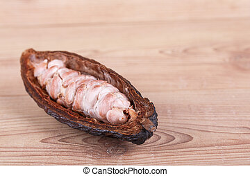 cocoa fruit on wooden background