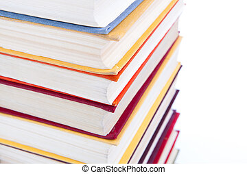 stack of books close-up - stack of books on a white...