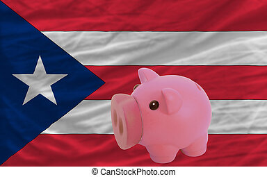 piggy rich bank and  national flag of puertorico