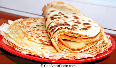 Pancakes - appetizing pancakes on red plate