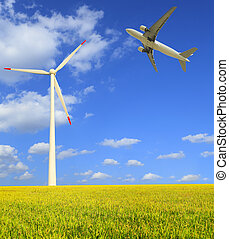Aircraft is flying in the rice farms Modern wind turbines -...