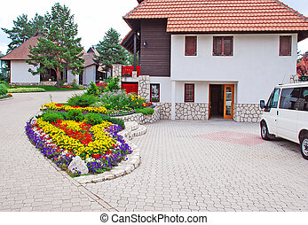 Cottage village - weekend houses with gardens and stone road...