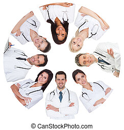 Low angle view of diverse group of doctors. Isolated on...